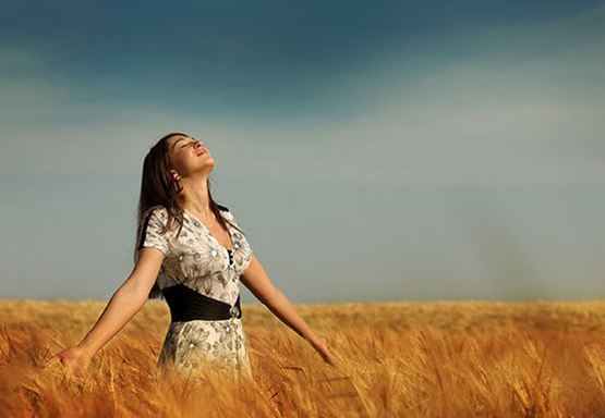 happy-woman-in-fields